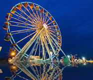 Ferris wheel with outdoor long exposure at reflect twilight. Royalty Free Stock Images