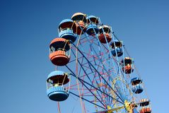 Ferris wheel over blue gradual sky Stock Images