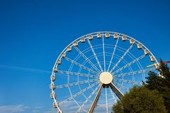 Ferris Wheel Over Blue Sky.  Royalty Free Stock Photography