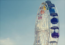 Ferris wheel over blue sky Stock Images