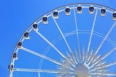 Ferris wheel over blue sky in Gdansk Stock Photos