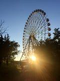 Ferris wheel over a blue sky at sunset Stock Photos