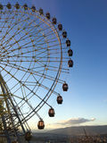Ferris wheel over a blue sky Stock Images