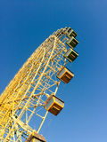 Ferris wheel over a blue sky Royalty Free Stock Photo