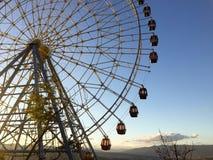 Ferris wheel over a blue sky Stock Photo