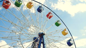 Ferris wheel over blue sky stock video footage