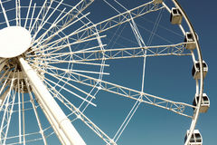 Ferris wheel over a blue sky. White ferris wheel over a blue sky Royalty Free Stock Images