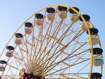 Ferris Wheel Over Blue Sky Stock Photos