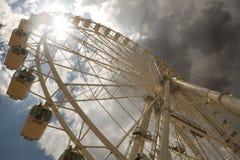 Ferris wheel over cloudy sky Stock Photos