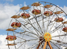Ferris wheel over sky. Ferris wheel in amusement park with cloudy sky in background Royalty Free Stock Photography