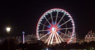 Ferris wheel in Paris at night stock photography