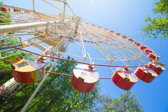 Ferris wheel in park on blue sky background view from down. Summ Royalty Free Stock Photo