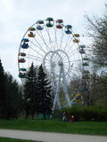 Ferris wheel in park. People relax.  Front view Stock Photography