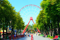 Ferris wheel and people walk in Gorky park in Kharkiv Royalty Free Stock Photos