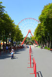 Ferris wheel and people walk in Gorky park in Kharkiv Stock Photography