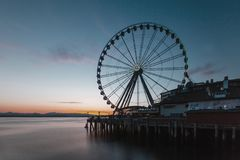 Ferris Wheel on Pier by the Sea in Seattle, USA stock photography