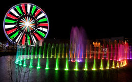 Ferris Wheel in Pigeon Forge, Tennessee during the Christmas Holidays. Taken at night with long exposure with colorful water fountain in foreground Royalty Free Stock Photos
