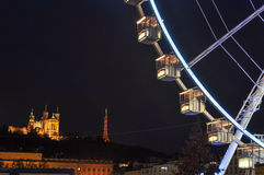 Ferris wheel at place Bellecour with La Fourviere, Lyon, France.  Royalty Free Stock Photography