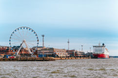 Ferris wheel, port and cruise ferry in Helsinki , Finland Royalty Free Stock Images
