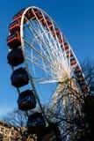 Ferris wheel in Princess Street Gardens, Edinburgh. A colourful red ferris wheel in Princess Street Gardens for the Christmas Market in Edinburgh, Scotland royalty free stock photo
