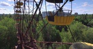 A Ferris wheel in Pripyat, near Chernobyl (Aerial, 4K) stock footage