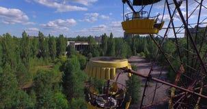A Ferris wheel in Pripyat, near Chernobyl (Aerial, 4K) stock video footage