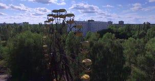 A Ferris wheel in Pripyat, near Chernobyl (Aerial, 4K) stock video