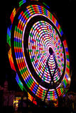 Ferris Wheel Rainbow Colors at Night Royalty Free Stock Photography