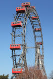 Ferris wheel with red cabines Stock Photos