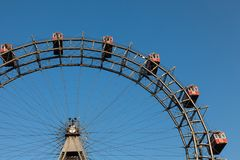 Ferris wheel with red cabines in Prater park, Vienna Stock Photography