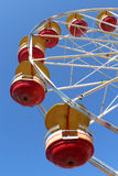 Ferris wheel with red and yellow cars Royalty Free Stock Photos