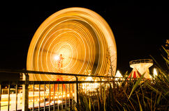 Ferris Wheel Ride in Motion. A ride spins in the night Stock Photos
