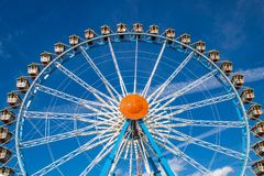 Ferris wheel Riesenrad on the Oktoberfest in munich/germany wi. Th blue sky and white clouds royalty free stock photos