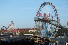 Ferris wheel and roller coaster at the Oktoberfest Stock Image