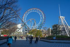 Ferris wheel and roller coaster at Tokyo Dome city Amusement Park. Tokyo, Japan - 17 February 2017: Ferris wheel and roller coaster at Tokyo Dome city Amusement Stock Image