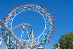 Ferris wheel and roller coaster at Tokyo Dome city Amusement Park. Tokyo, Japan - 17 February 2017: Ferris wheel and roller coaster at Tokyo Dome city Amusement Stock Photography