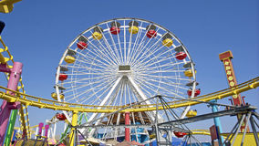 Ferris Wheel and Roller Coaster Track. Image of an amusement park with a ferris wheel and roller coaster track Stock Photos