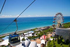 Ferris wheel and ropeway. In the seaside Stock Image