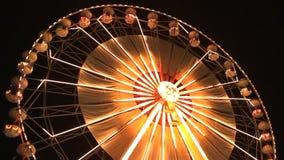 Ferris wheel rotating at night stock video