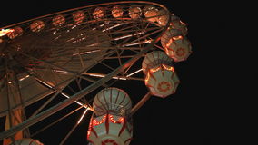 Ferris wheel rotating at night stock video footage