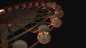 Ferris wheel rotating at night stock video footage