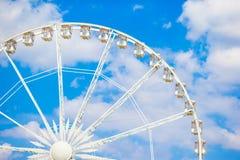 Ferris wheel Roue de Paris on the Place de la Concorde from Tuileries Garden in Paris, France Royalty Free Stock Image