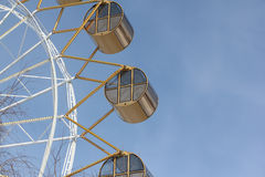 Ferris wheel  with the round closed cabins against the backgroun Stock Photos
