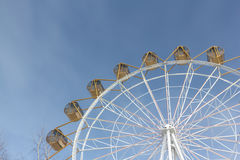 Ferris wheel  with the round closed cabins against the sky Royalty Free Stock Image