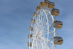Ferris wheel  with the round closed cabins against the sky Stock Images