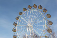 Ferris wheel  with the round closed cabins against the sky Royalty Free Stock Photo