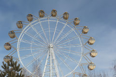 Ferris wheel  with the round closed cabins against thesky Stock Photo