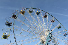 Ferris wheel  with round open cabins against of the blue sky Royalty Free Stock Image
