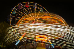 Ferris wheel and roundabout Royalty Free Stock Image