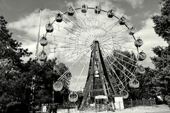 The Ferris wheel in the Russian province. Ferris wheel. Black and white photo royalty free stock image